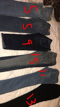 Three black and blue denim jeans