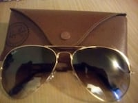 black Ray-Ban Aviator sunglasses with silver frame 3731 km