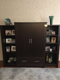 Contemporary wood Entertainment Center with left and right bookcases.
