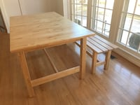 Dining table with bench extends to seat 8