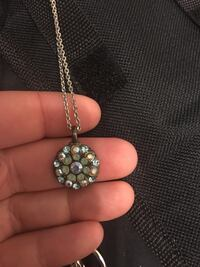 round gold-colored diamond encrusted pendant Peterborough, K9H 3E4