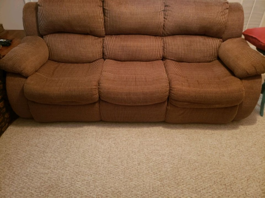 Photo Reclining cloth sofa made by Rooms-to-Go.