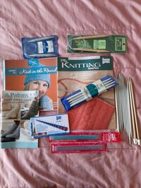 3 knitting books and 24 assorted needles