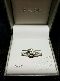 silver-colored Kay Jewelers ring with box 306 mi