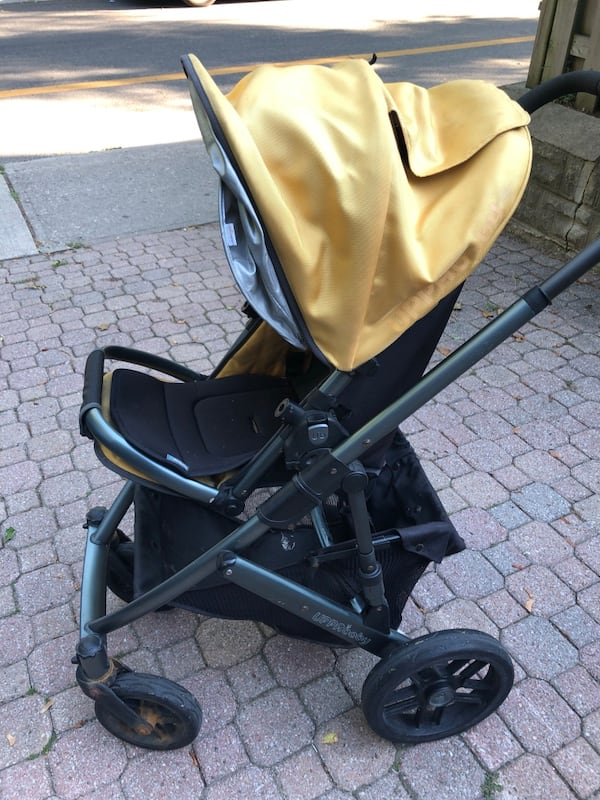 Uppababy Vista stroller, 2011. Black metal with yellow accents. 93f7cade-da81-4ba2-9227-1e04d5b8a5bf