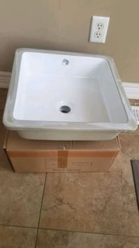 NEW undermount ceramic vanity sink.