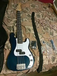 blue and white bass guitar