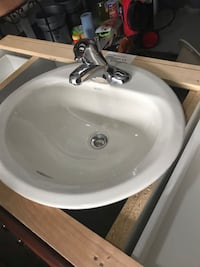 White ceramic sink with faucet Mississauga, L5R 3Y7
