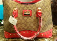 monogrammed brown and pink Coach leather shoulder bag Tuscaloosa