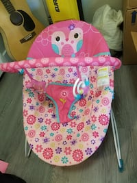 baby's pink and white floral bouncer