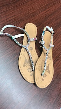 pair of brown-and-white thong sandals
