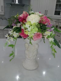 white, red, and green floral arrangement with white ceramic vase