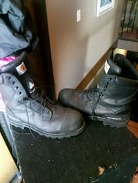 pair of black Carhartt logger boots Sylvan Lake, T4S 1L9