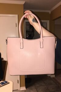Large purse kind of a rosy beige color. Brand new with tags. VEGAN Destrehan, 70047