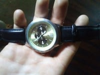 round silver-colored analog watch with black leather strap Winnipeg, R2L 1B2