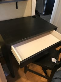 rectangular black wooden table with chairs Denver, 80205