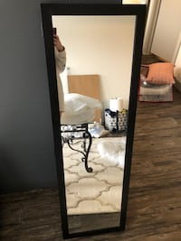 Hanging body length mirror with cabinet