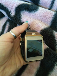 silver , black and brown smart watch