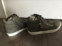 Women's pair of size 6.5 khaki high top sneakers brand new
