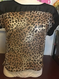 brown and black leopard print armchair 3149 km