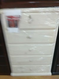 white and gray wooden 4-drawer chest