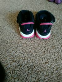 pair of black-and-pink Nike basketball shoes Muskegon, 49442