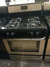 silver and black 4-burner induction gas stove 53 km