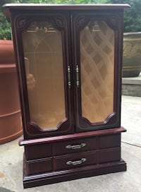 Brown wooden jewelry cabinet with drawer