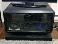 Black wooden TV stand, with glass doors Surrey, V3X 0B9