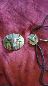 Bolo tie and matching belt buckle.