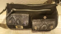 "Guess, brand, small purse. Measures 10"" by 5"", new 2242 mi"