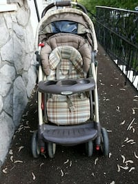 baby's gray and black stroller Laval, H7N 1L5