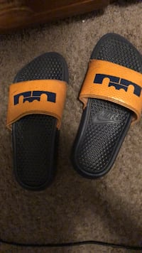 pair of yellow-and-black Nike slide sandals Lake Mary, 32746