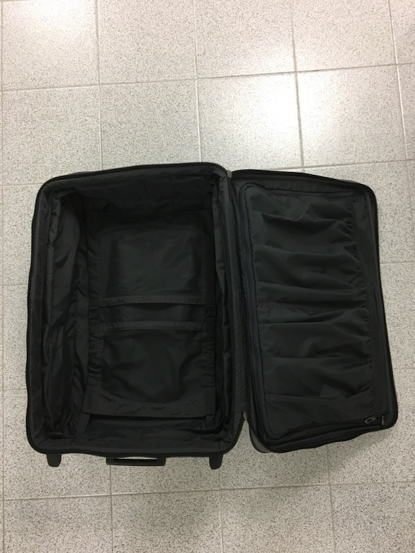 Delsey Rolling Suitcase Luggage 17a9e989-c4be-4467-a37c-8bccd249229d