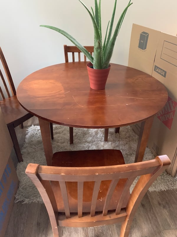 Wood table great for repurposed has scratches folds into a two seated table... moving need gone by 8/19 47a7f234-eb7a-40e2-9665-c6aa3e2bb3bf