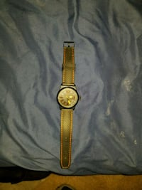 round gold analog watch with gold link bracelet Washington, 20002