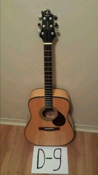 brown and black acoustic guitar Montréal, H4B 1P1