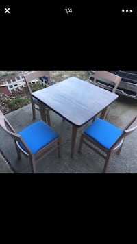 Square brown wooden table with four chairs Ocoee, 34761