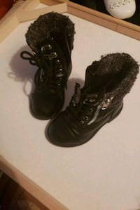 pair of black leather boots Lansing, 48910
