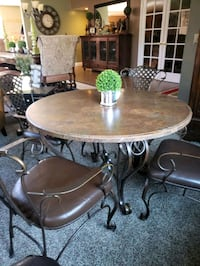 Granite top wrought iron dining set with 4 chairs