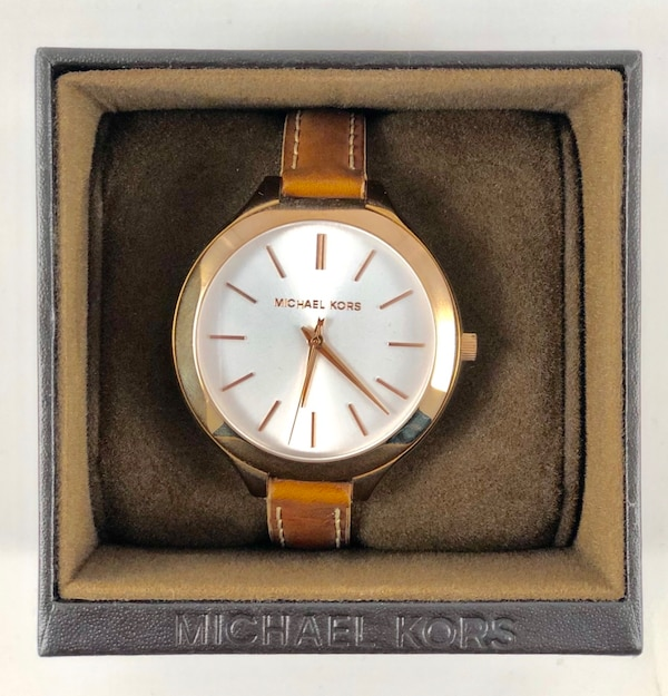 round gold Michael Kors analog watch with brown leather strap 1