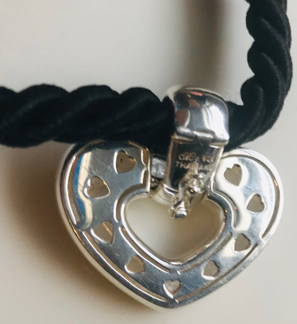 Beautiful and heavy silver pendent and necklace. e71bd34c-ac8f-4c41-b73d-d1cc3ffc2f2f