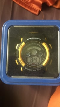 black and yellow digital watch 392 mi