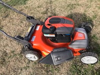 red and black push mower Rogers