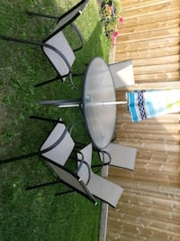 Patio table,5 chairs and a beach umbrella Milton, L9T 2X5