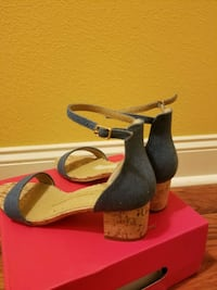 pair of blue denim open toe ankle strap wedge sand