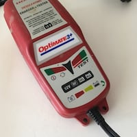 red and black Black & Decker battery charger Calgary, T2T 1Y7