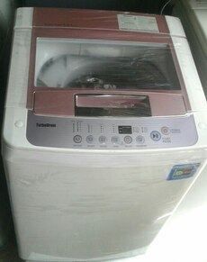 brown, grey, and white TurboDrum top load washing machine