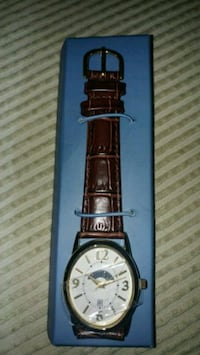 round silver analog watch with brown leather strap Montreal, H8T