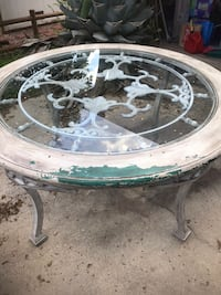 Metal table with glass top.  Chairs are metal as well   1374 mi